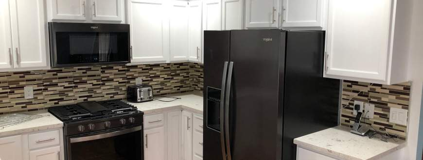 Kitchen remodeling Kitchen remodeling.paintin the cabinets,installation backsplash,installation countertops,installation new faucet,disposal,instal...