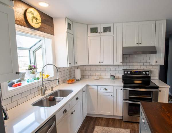 KVK LLC - Kitchen DeltPh Complete kitchen remodel including opening up a wall to create an open concept kitchen and living room.